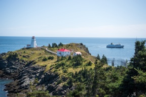 The Grand Manan V Ferry pasing Swallowtail Lighthouse on the way into harbour